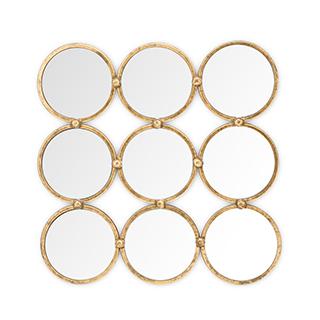 Miroir avec contour de métal doré
